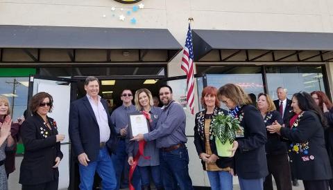 Javier Casillas and Gretchen Garrett with the Alamogordo Chamber of Commerce Plague