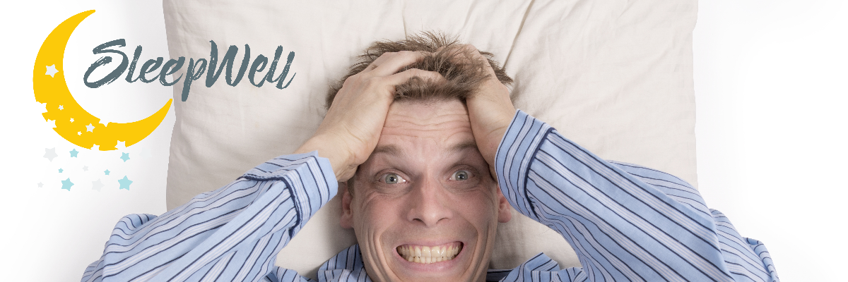 Man having trouble sleeping. Pillow and man with hands in hair frustrated