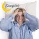Man frustrated by lack of sleep. On pillow with hands in hair