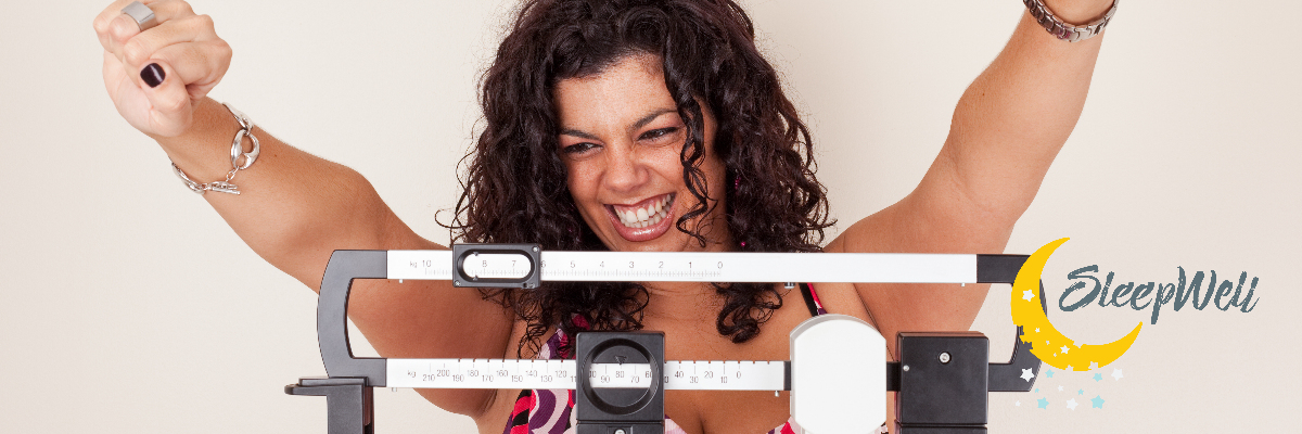 Woman on Scale beating the weight, Happy weigh in