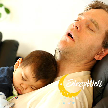 Father with child on recliner asleep