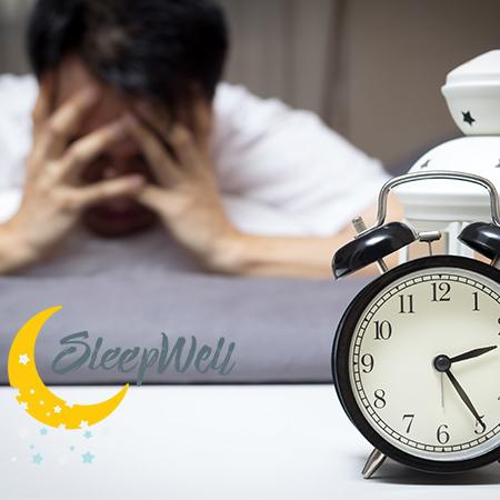 Man Stressing next to mattress. Sleep better with Sleep Well